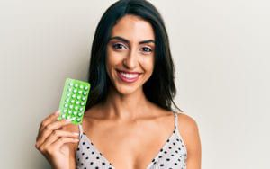 Smiling Woman with Birth Control Pills