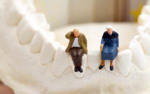Elderly couple on rendered jawbone